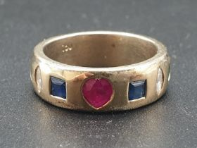 18K Yellow Gold Diamond, Ruby, Sapphire and Emerald band ring. Weighs 9.5g and Size M. 0.16ct