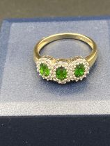 9 Carat Gold trilogy ring set with Green TOURMALINE and DIAMONDS. 2.3 grams . Size M.