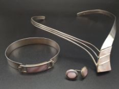 A modern sterling silver (stamped 925) and pink mother of pearl necklace, bangle and earrings set