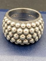 Silver ring by Ti Cento of Milan having silver bead ?keeper? design to top . Clear marking inside