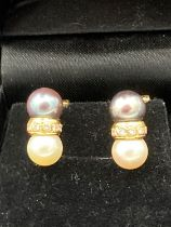 Pair of 18 CARAT GOLD DIAMOND and PEARL earrings . 5.4 grams. Top Quality pair of classic earrings.