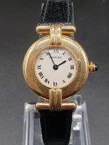 18k yellow gold Cartier quartz ladies watch, white round face and black leather strap