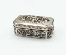 AN EARLY 19TH CENTURY CHINESE SILVER BOX WITH TRADITIONAL HAND CHASED DECORATION. 59.4gms 7.5 x 4cms