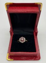 A VINTAGE 18K GOLD RUBY AND DIAMOND CLUSTER RING. 4.5gms size O