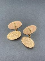 Vintage 9 Carat Gold chain cufflinks ,chased with scroll and floral design . 5.8 grams.
