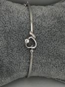 9k white gold bangle with diamond 0.15ct; 10.30g