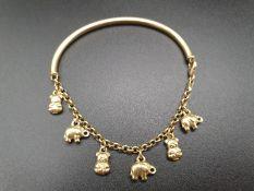 18K Yellow Gold Half-Moon Charm Bracelet. Six animal charms. 8.02g