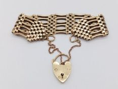 A 9K Yellow Gold Ladder-Link Bracelet with 9K Heart Charm/Clasp. 18cm. 35.03g