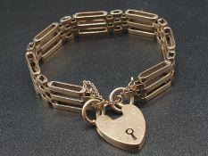 9K Yellow Gold Ladder-Link Bracelet with Heart Charm. 16cm. 21.84g