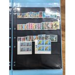 SIX FOLDERS each containing a separate selections comprising Rhodesia moderns, World Cup MSs and