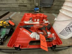Hilti DX 460 GR ram set including large assortment of tooling, shot cartridges, and lag bolts and
