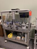 Custom automated needle assembly machine with integrated UV gluing and vision inspection