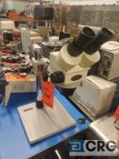 Omano microscope with arm and base