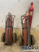 Lot of (3) fire extinguisher tank pieces, including (2) carbon dioxide rolling carts with hoses, and