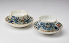 Arte Cinese A pair of porcelain export cups and dishes China, Qing dynasty, 18th century .