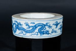 Arte Cinese A porcelain blue and white inkwell element painted with dragons chasing the flaming pea