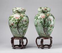 Arte Cinese A pair of porcelain potiches over celadon groundChina, early 20th century .