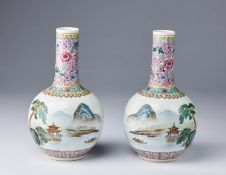 Arte Cinese A pair of famille rose porcelain tianchuping vases painted with landscape and bearing a