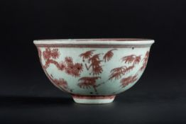 Arte Cinese A red iron porcelain bowl painted with floral motifs China, 20th century or earlier .