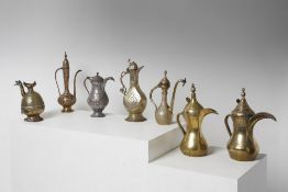 Arte Islamica  A collection of seven metal engraved large coffee pots Central Asia, Iran and Kashmir