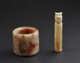 Arte Cinese  Two jade artifacts.China, Qing dynasty, 19th century..