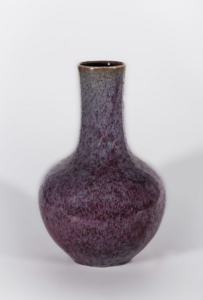 Arte Cinese A pottery flambé glazed lavander and red bottle vase China, late 19th century.