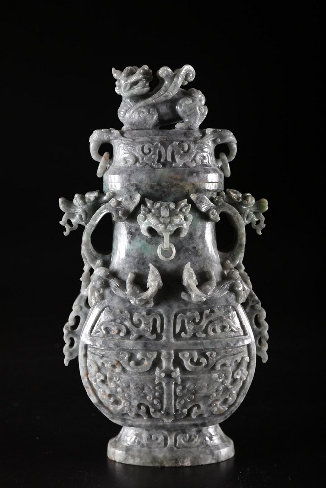 Arte Cinese A grey jadeite carved vase with archaic shape and decoration of taotie masks, chilong s