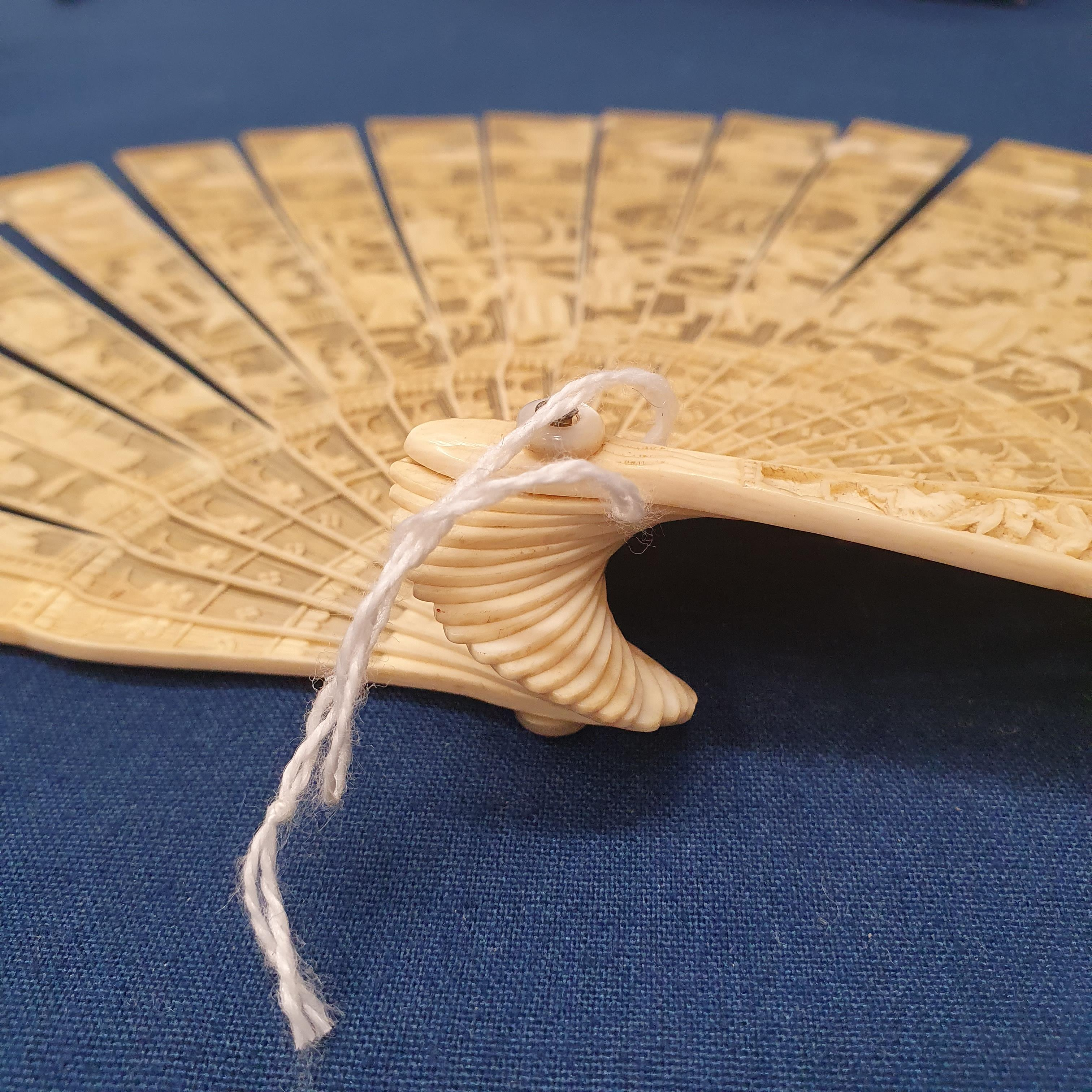 A Chinese ivory brisee fan, two others, and a similar fan with silk embroidered decoration, in a - Image 18 of 47
