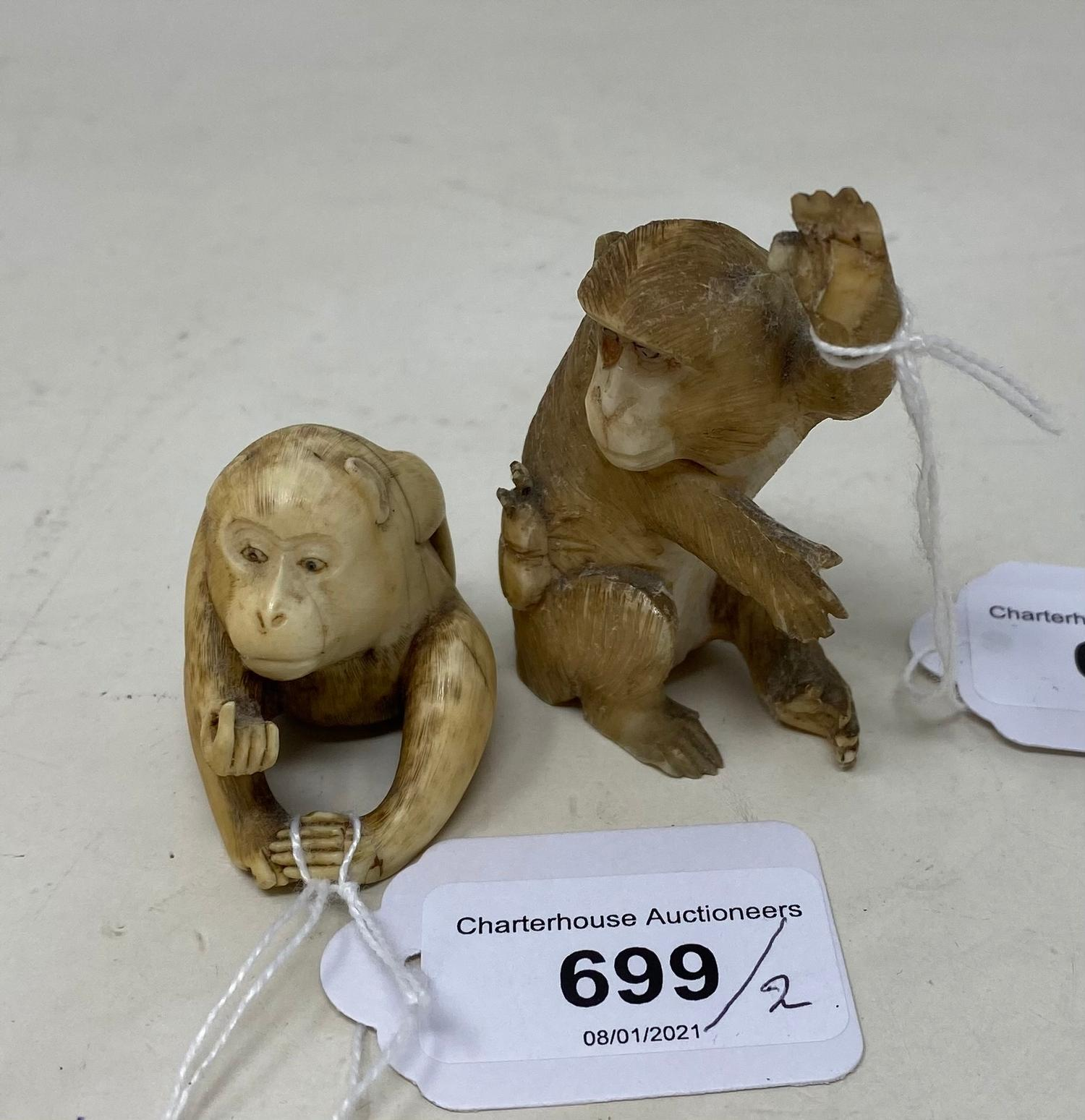 A Japanese carved ivory monkey, 8 cm, and another, 4 cm
