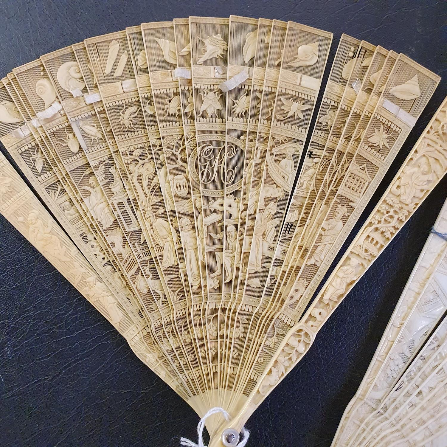 A Chinese ivory brisee fan, two others, and a similar fan with silk embroidered decoration, in a