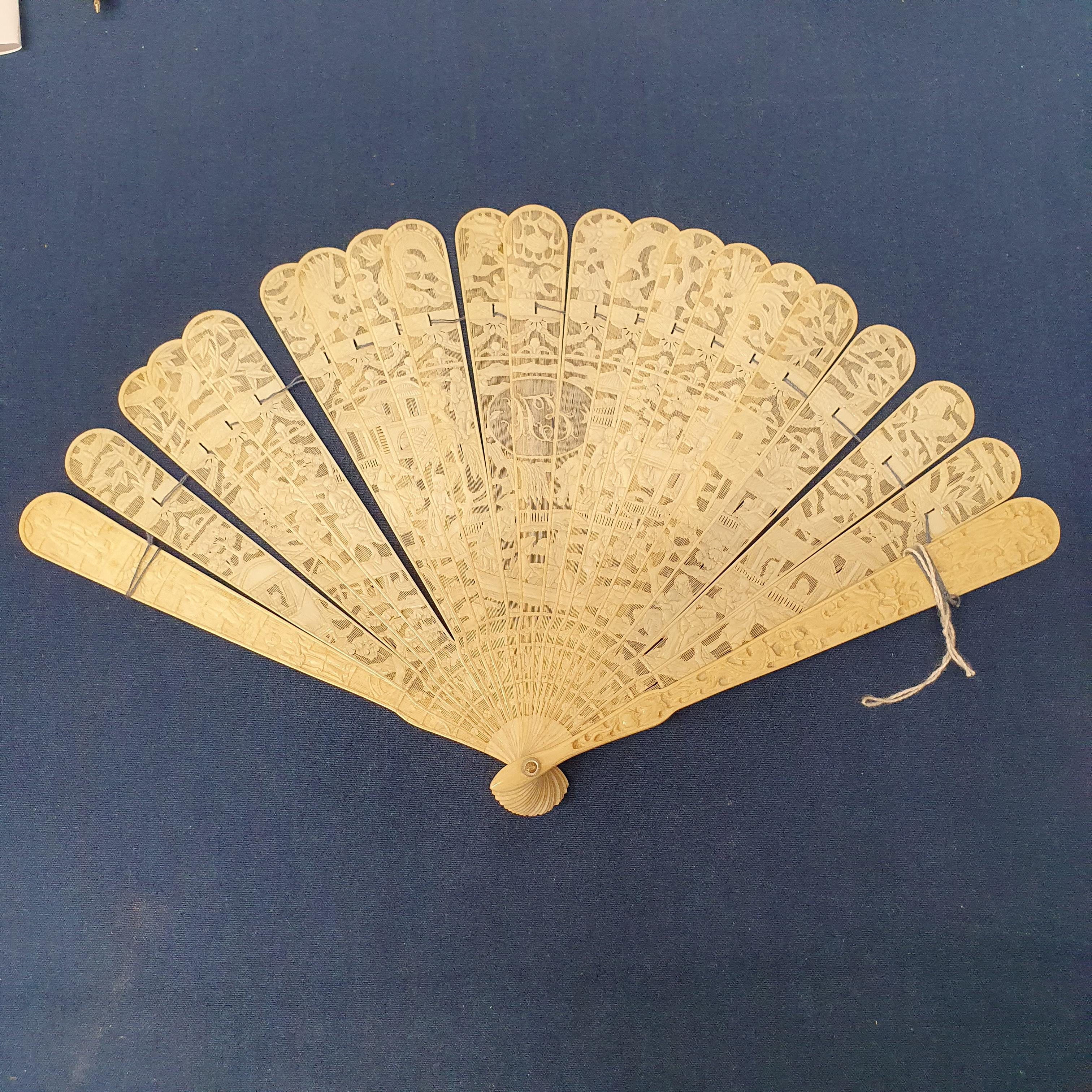 A Chinese ivory brisee fan, two others, and a similar fan with silk embroidered decoration, in a - Image 32 of 47