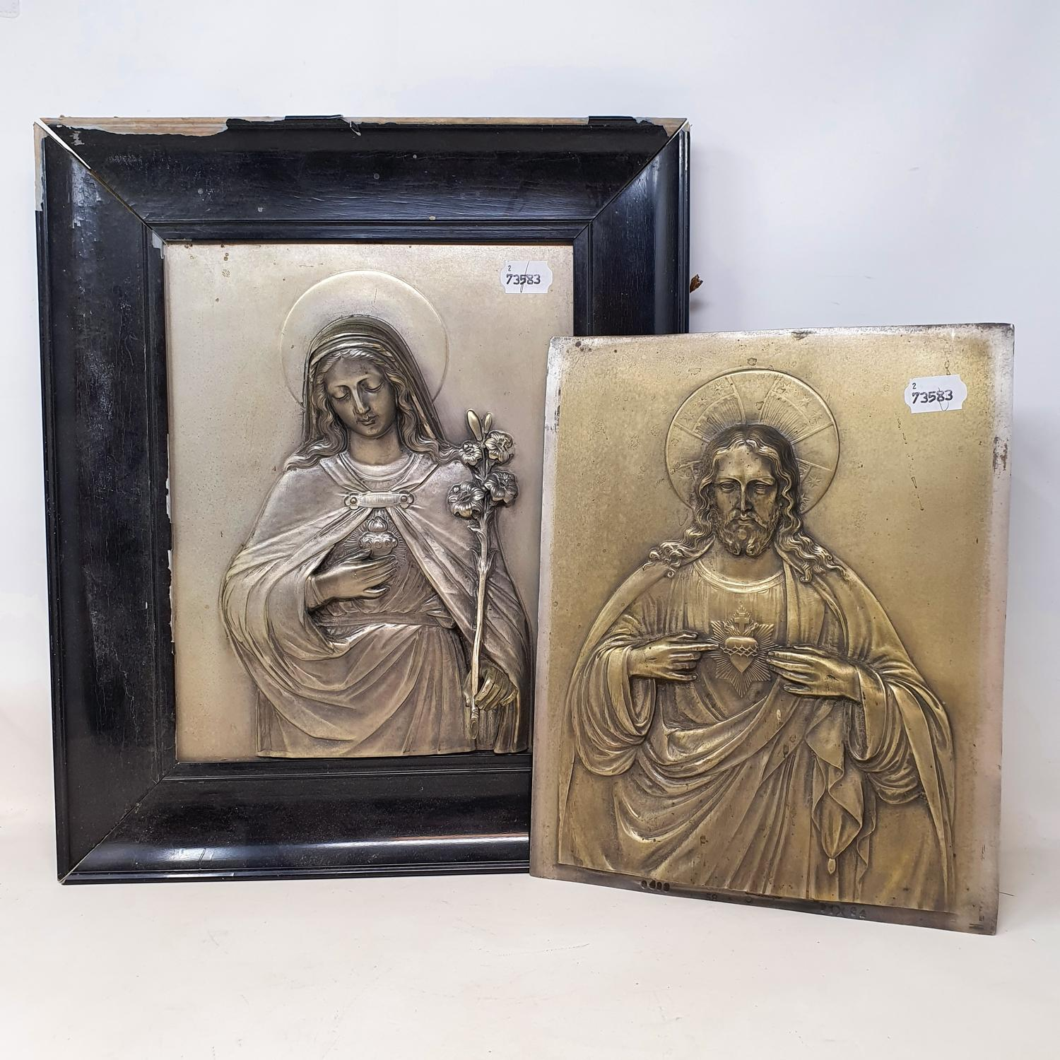 Two silver plated religious icons, of Jesus Christ and Mary of the Sacred Heart, 33 x 25 cm
