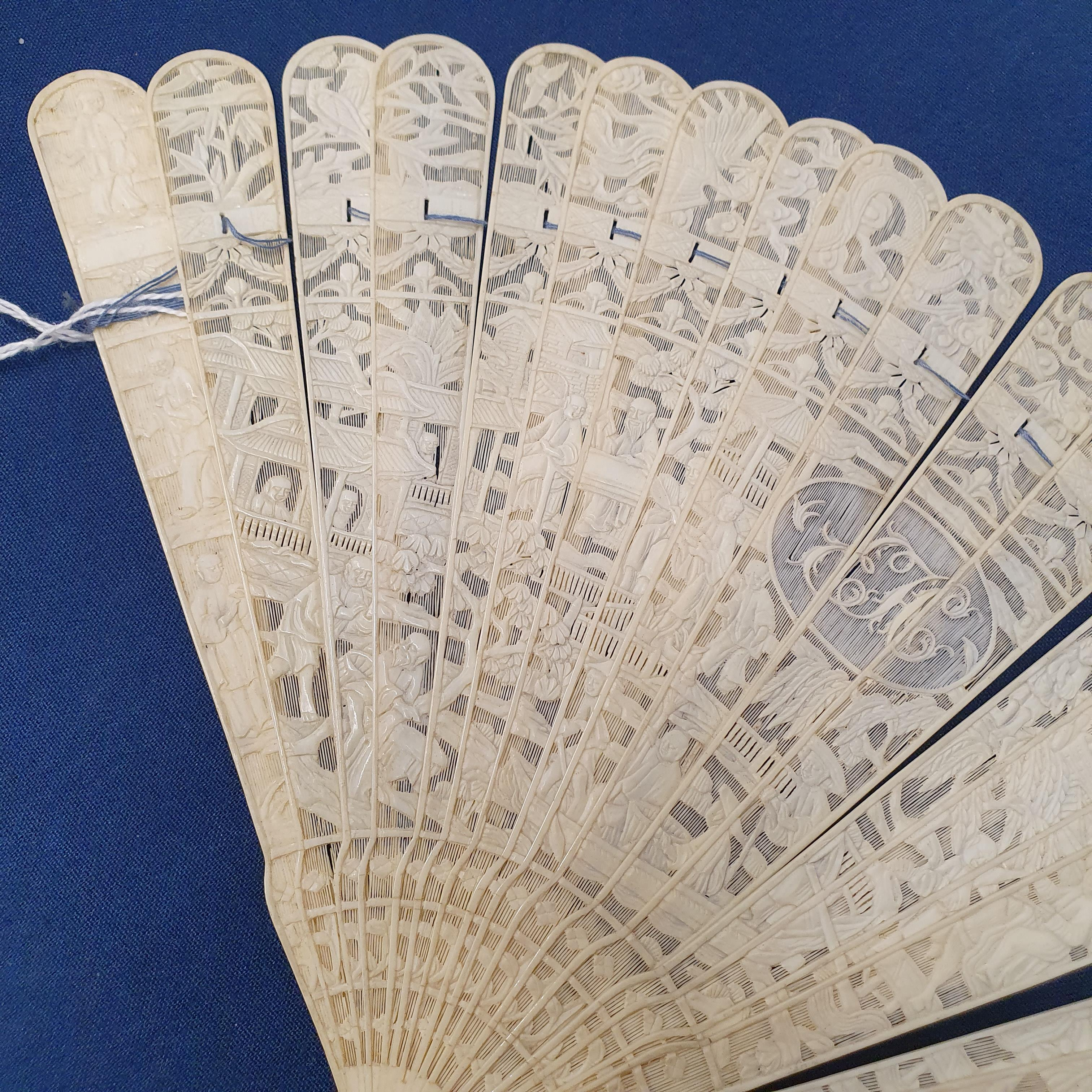 A Chinese ivory brisee fan, two others, and a similar fan with silk embroidered decoration, in a - Image 26 of 47