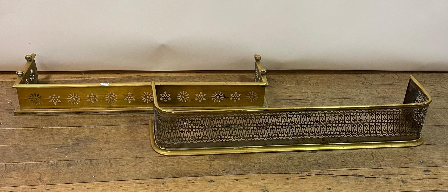 A 19th century brass fender, 102 cm wide, and another, 104 cm wide