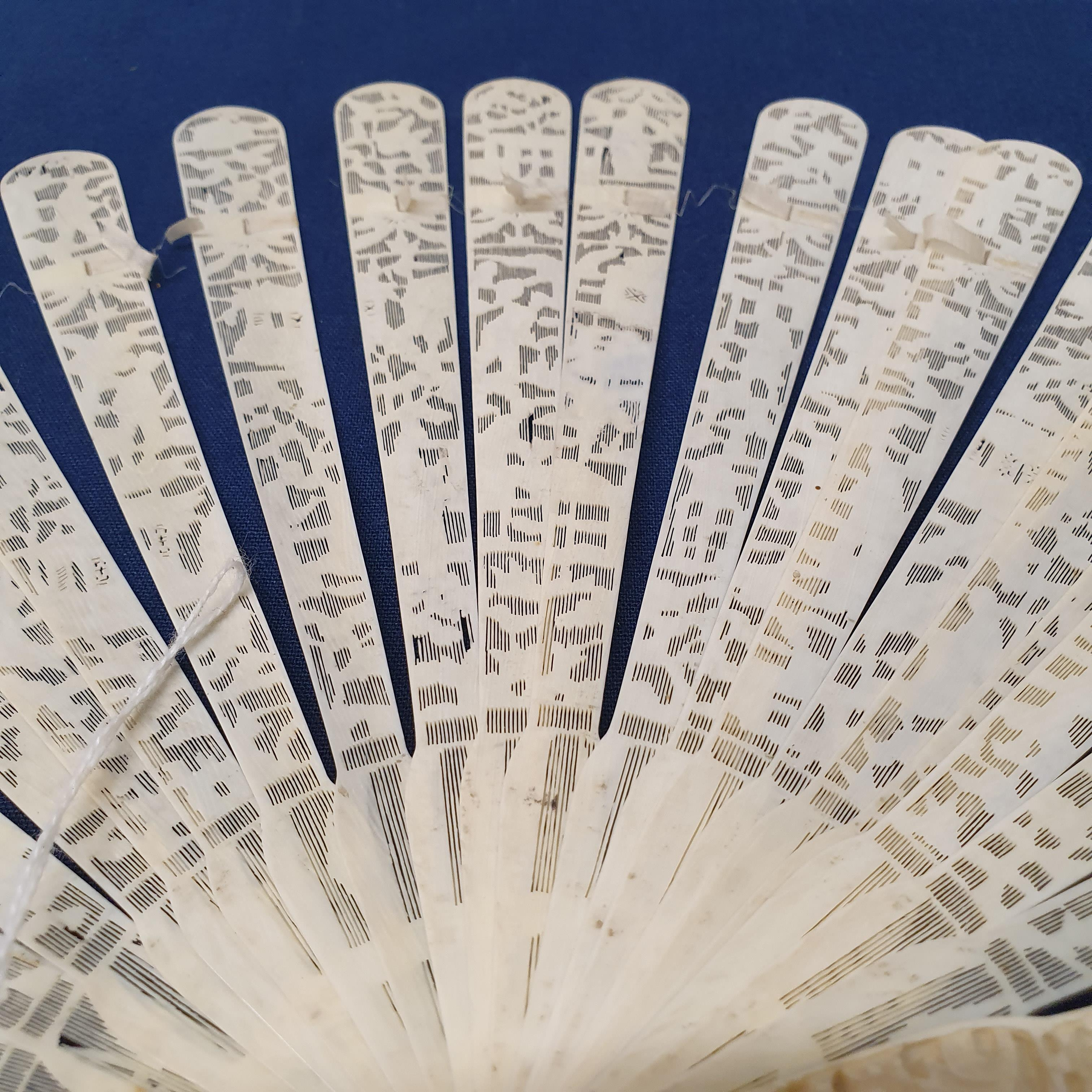 A Chinese ivory brisee fan, two others, and a similar fan with silk embroidered decoration, in a - Image 44 of 47
