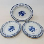 A set of three early 19th century blue and white oval dishes, with pierced rims, decorated