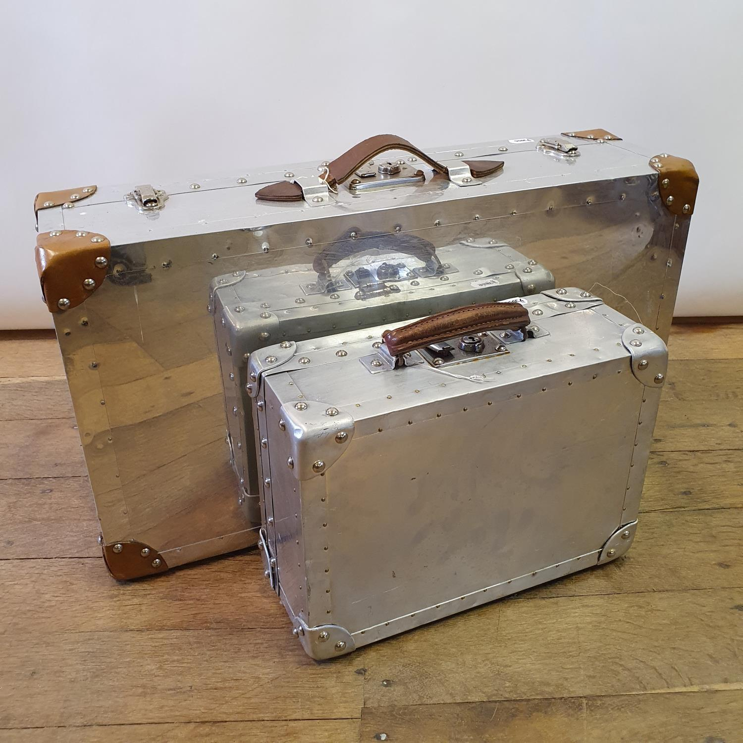 An aluminium suitcase box, 67 cm wide, and another, 36 cm wide