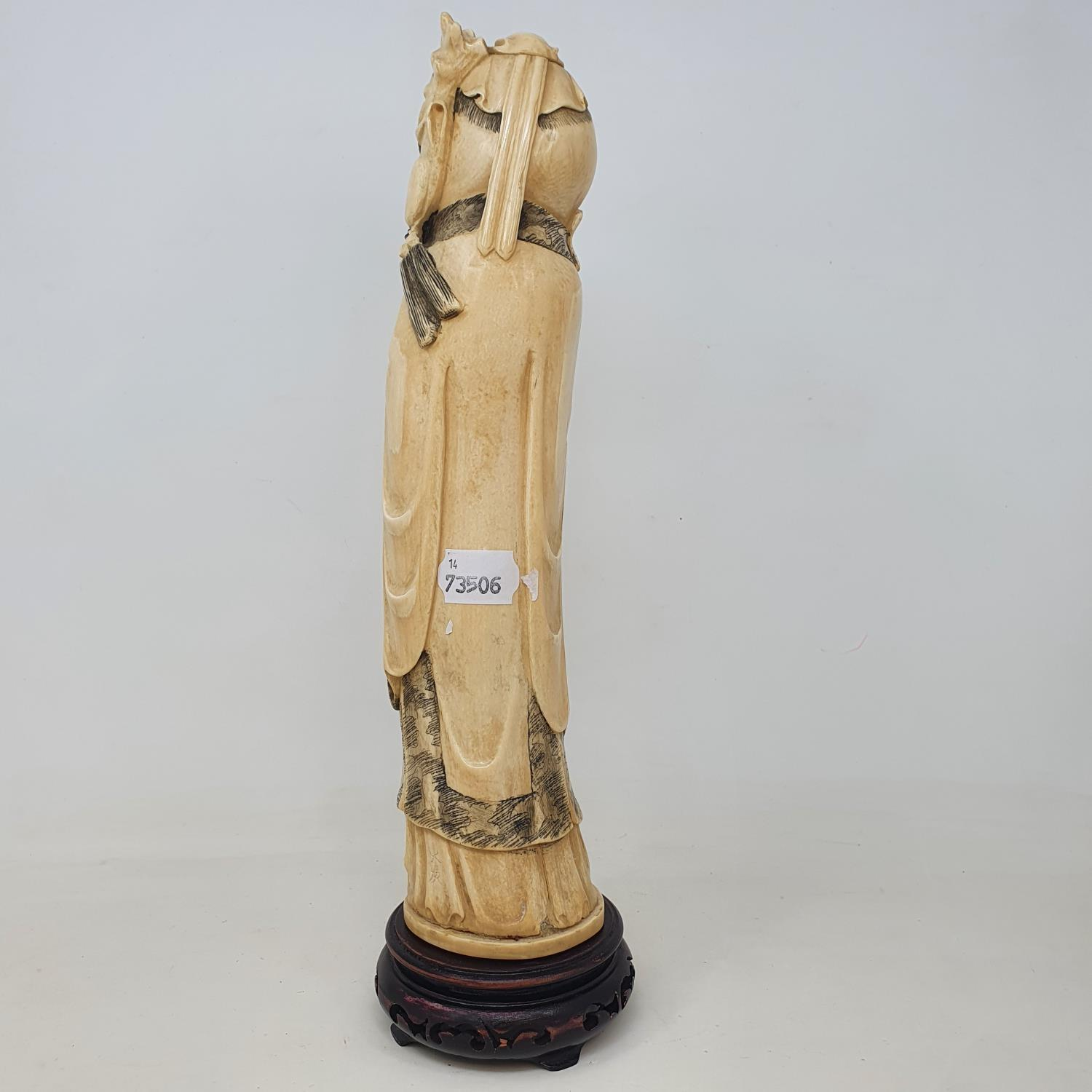 An early 20th century Chinese ivory tusk, carved in the form of Shou Lao, on wooden base, 38 cm - Image 3 of 3