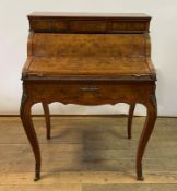 A Louis XV style bureau de dame, veneered in burr walnut, the superstructure with three drawers