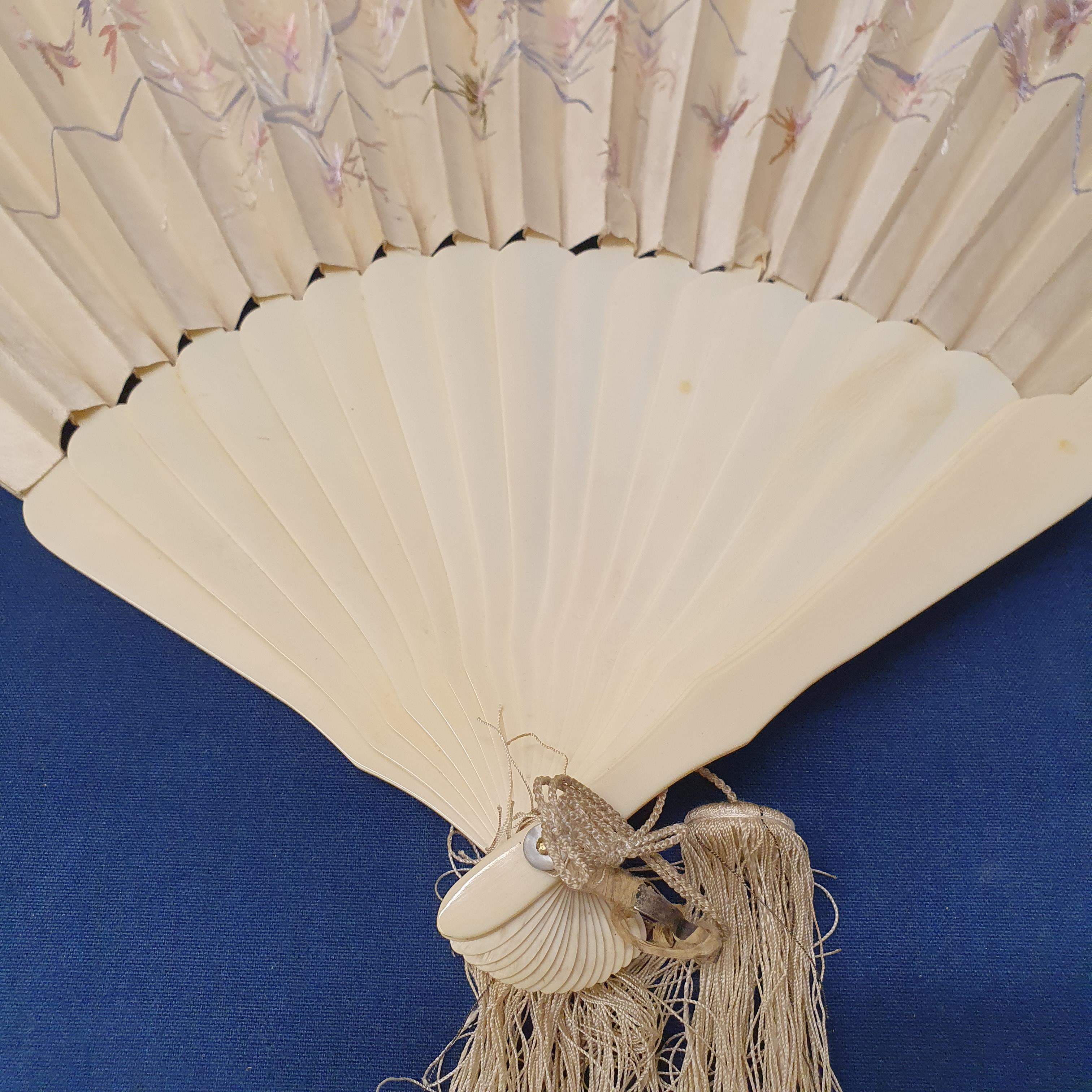 A Chinese ivory brisee fan, two others, and a similar fan with silk embroidered decoration, in a - Image 47 of 47