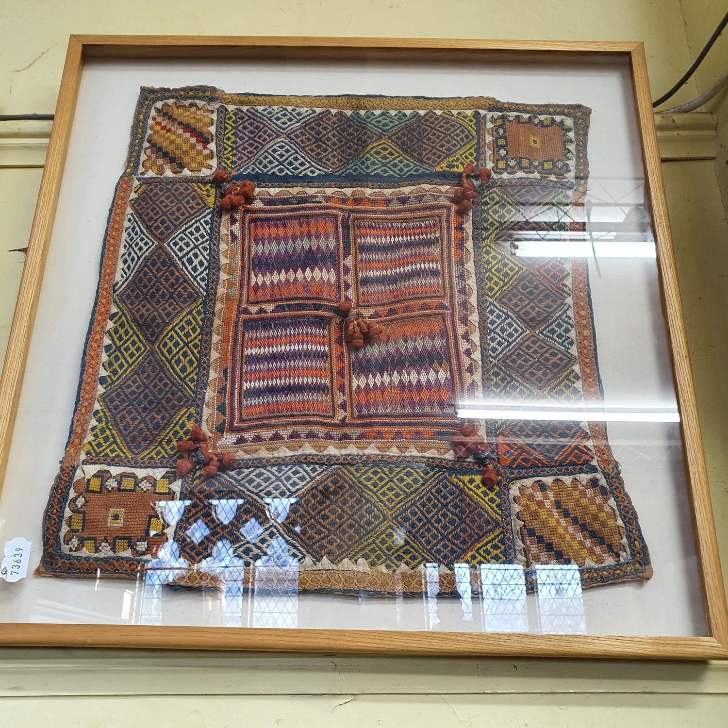 A South American embroidered panel, 44 x 44 cm and three other framed fabrics (4) - Image 4 of 4
