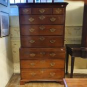 A 19th century mahogany chest on chest, the top with three short and three long drawers, above three