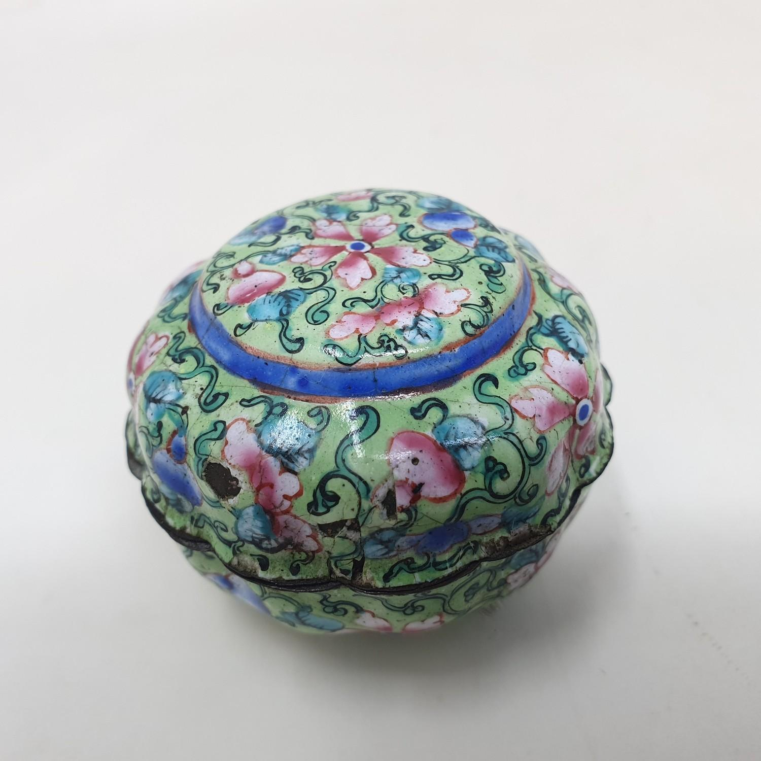A Canton enamel pot and cover, decorated flowers on a green ground, 3 cm diameter