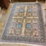 A Persian cream ground carpet, with a main blue border, centre with repeating square medallions, 340