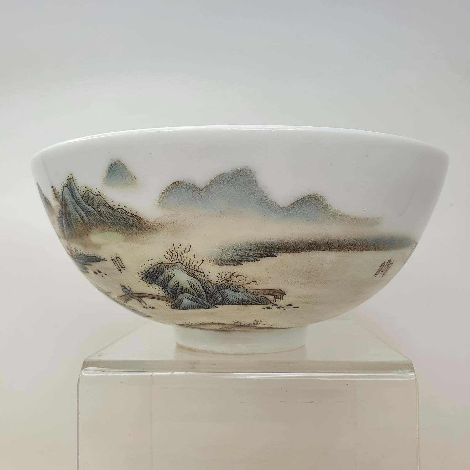 A Chinese porcelain bowl, decorated a mountainous landscape with figures and buildings, six - Image 7 of 7