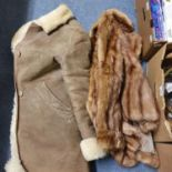 A fur jacket, a sheepskin coat, and other items (box)