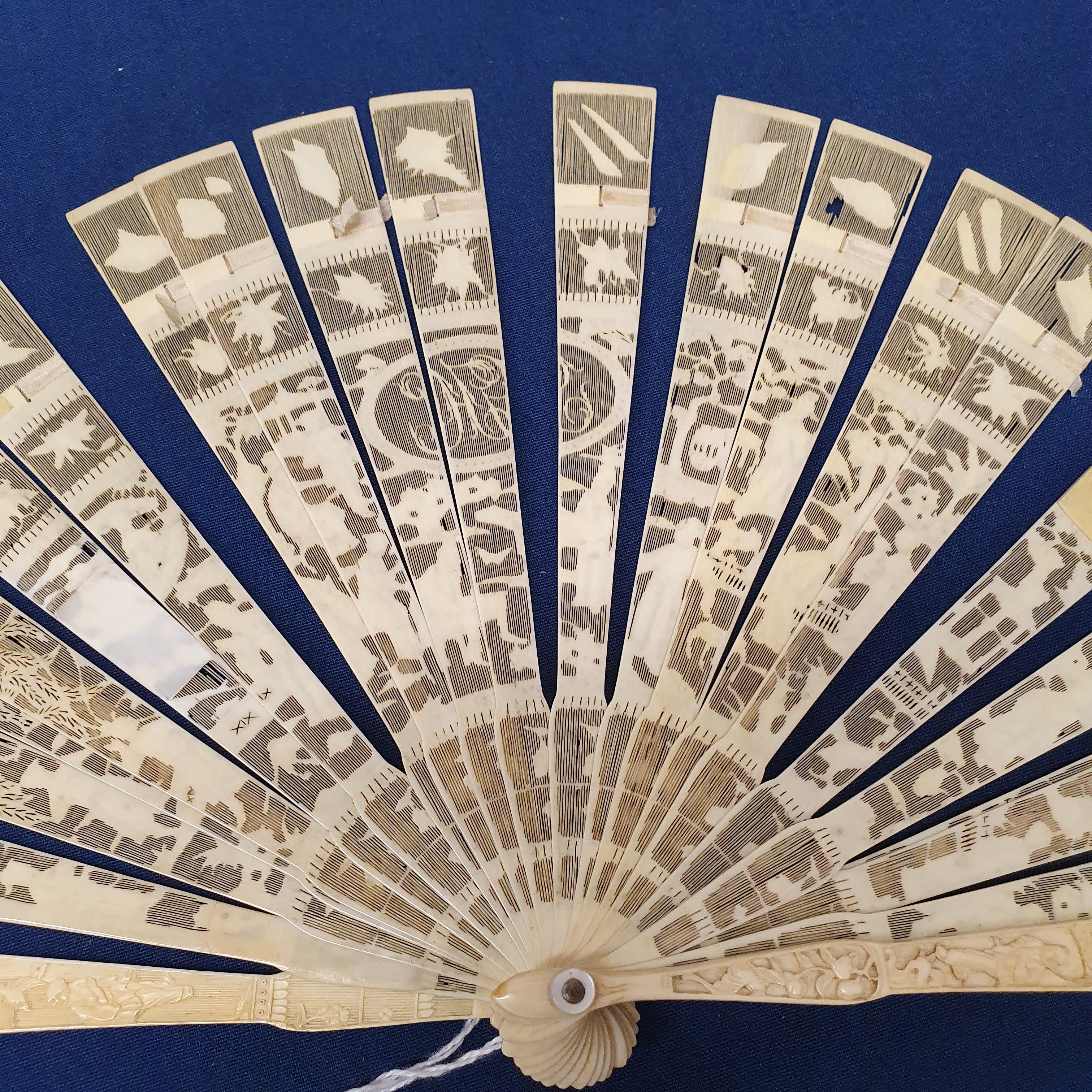 A Chinese ivory brisee fan, two others, and a similar fan with silk embroidered decoration, in a - Image 22 of 47