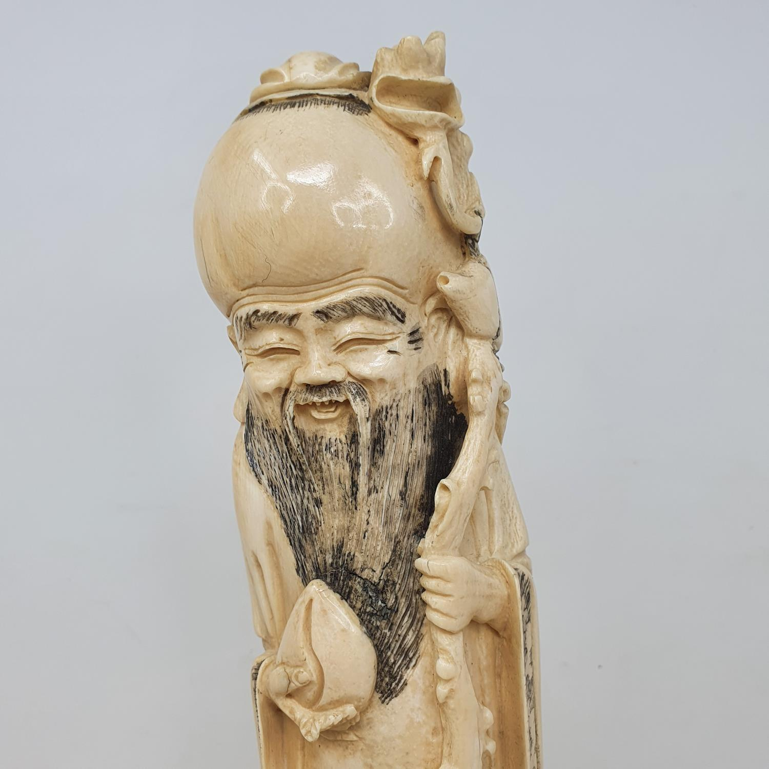 An early 20th century Chinese ivory tusk, carved in the form of Shou Lao, on wooden base, 38 cm - Image 2 of 3