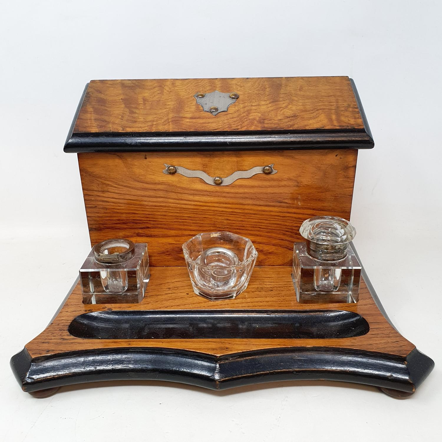 A 19th century rosewood tea caddy, with mother of pearl inlay, 33 cm wide, and an oak desk stand, 23 - Image 2 of 5