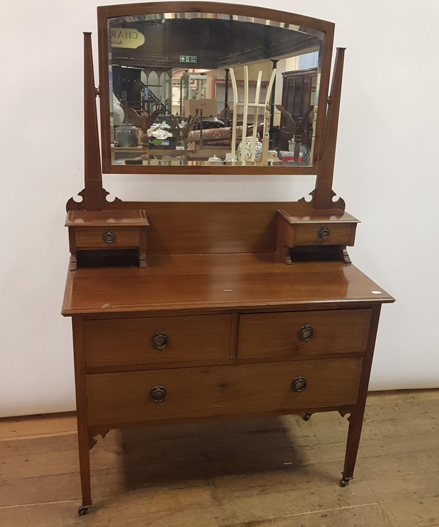 A 19th century mahogany chest, having two short and three long graduated drawers, on turned feet, - Image 2 of 2
